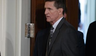 FILE - In this Feb. 13, 2017 file photo, Michael Flynn arrives for a news conference in the East Room of the White House in Washington. The Defense Intelligence Agency is refusing to publicly release a wide array of documents related to former National Security Adviser Michael Flynn, saying that turning them over could interfere with ongoing congressional and federal investigations. (AP Photo/Evan Vucci, File)