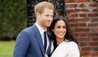 Prince Harry and Meghan Markle    Associated Press photo