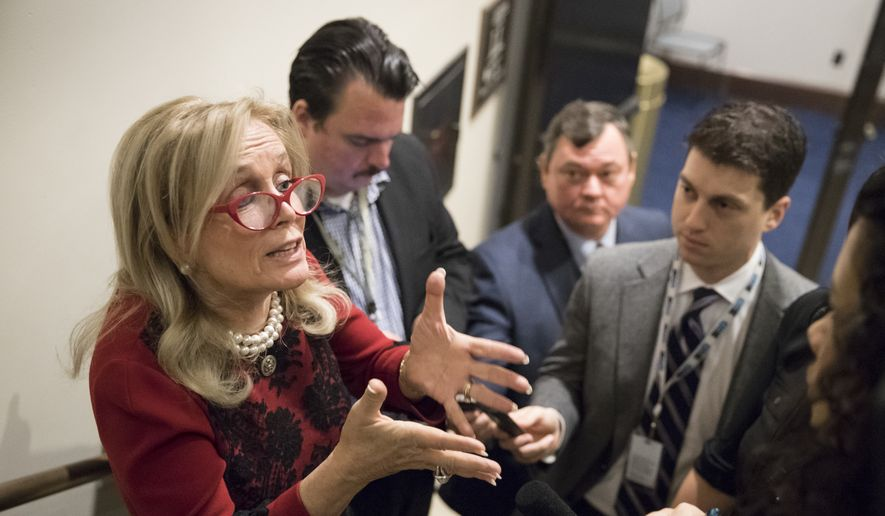Rep. Debbie Dingell, D-Mich., left, responds to reporters after members of the House Democratic Caucus met on Capitol Hill in the wake of reports of sexual misconduct by Rep. John Conyers, D-Mich., the longest-serving member of the House, in Washington, Wednesday, Nov. 29, 2017. (AP Photo/J. Scott Applewhite) ** FILE **