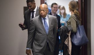 Rep. John Lewis, D-Ga., and other members of the House Democratic Caucus leave a meeting on Capitol Hill in the wake of reports of sexual misconduct by Rep. John Conyers, D-Mich., the longest-serving member of the House, in Washington, Wednesday, Nov. 29, 2017. Conyers returned to his home in Detroit, Tuesday. (AP Photo/J. Scott Applewhite)