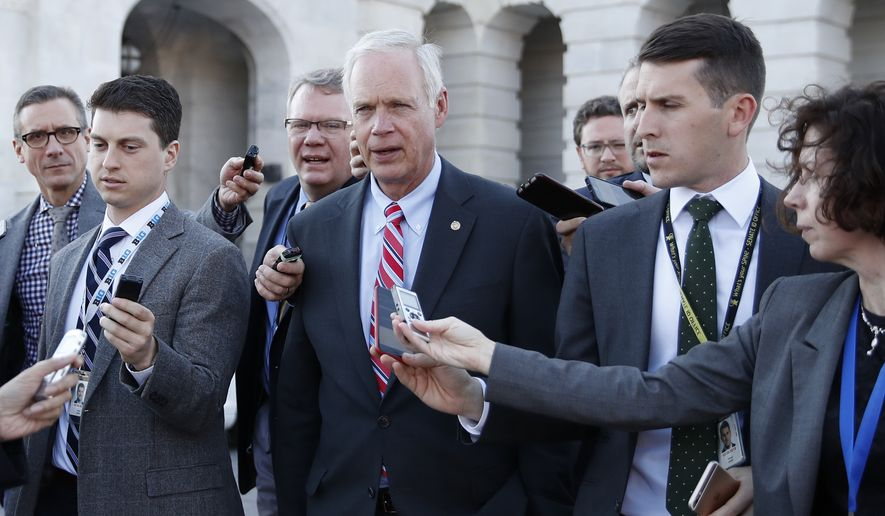 Sen. Ron Johnson, R-Wis., is surrounded by media as he walks from the Capitol building on Capitol Hill in Washington, Wednesday, Nov. 29, 2017. (AP Photo/Carolyn Kaster) **FILE**