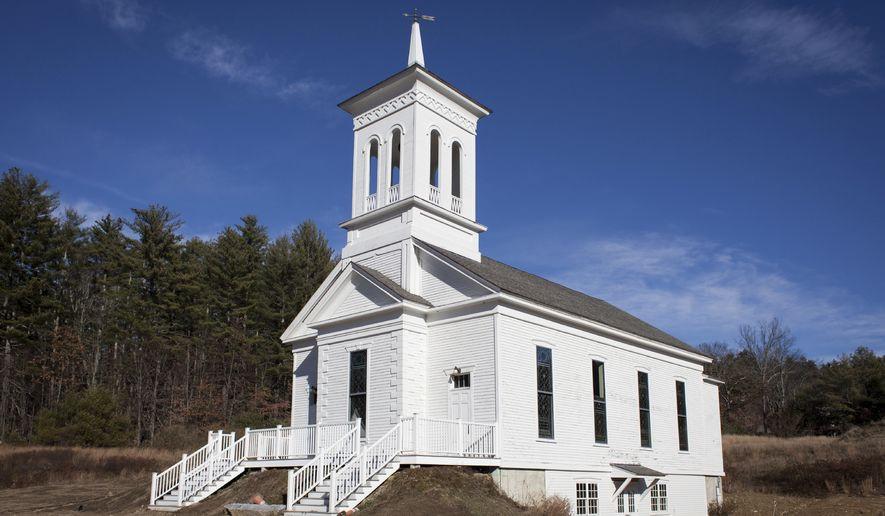 ADVANCE FOR WEEKEND EDITIONS, DEC. 2-3 - This Thursday, Nov. 23 2017 photo, shows the exterior of the historic Epsom Bible Church, moved to its current location in 2007 next to the town library, in Epsom, N.H. The same year it was moved, a New Hampshire Land and Community Heritage Investment Program grant helped make significant improvements to the building, often referred to as the meetinghouse. (Elizabeth Frantz/The Concord Monitor via AP)