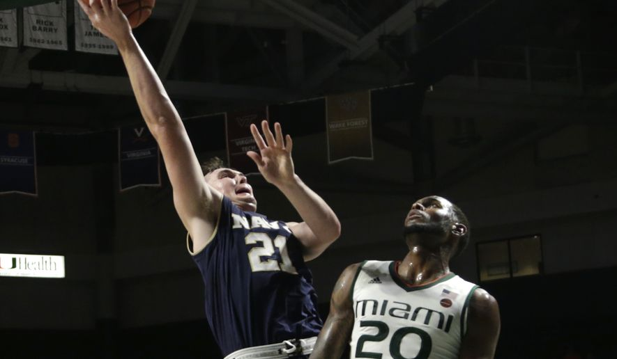 Navy's George Kiernan (21) shoots over Miami's Dewan Huell (20) during the second half of an NCAA college basketball game, Sunday, Nov. 12, 2017, in Coral Gables, Fla. Miami won 89-55. (AP Photo/Lynne Sladky) **FILE**