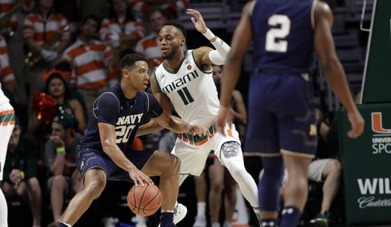 Navy's Shawn Anderson (20) drives as Miami's Bruce Brown Jr. (11) defends during the first half of an NCAA college basketball game, Sunday, Nov. 12, 2017 photo, in Coral Gables, Fla. (AP Photo/Lynne Sladky) **FILE**