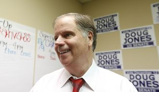 Democratic Senate candidate Doug Jones stops along the campaign trial to greet volunteers, Wednesday, Nov. 29, 2017, in Montgomery, Ala.(AP Photo/Brynn Anderson)