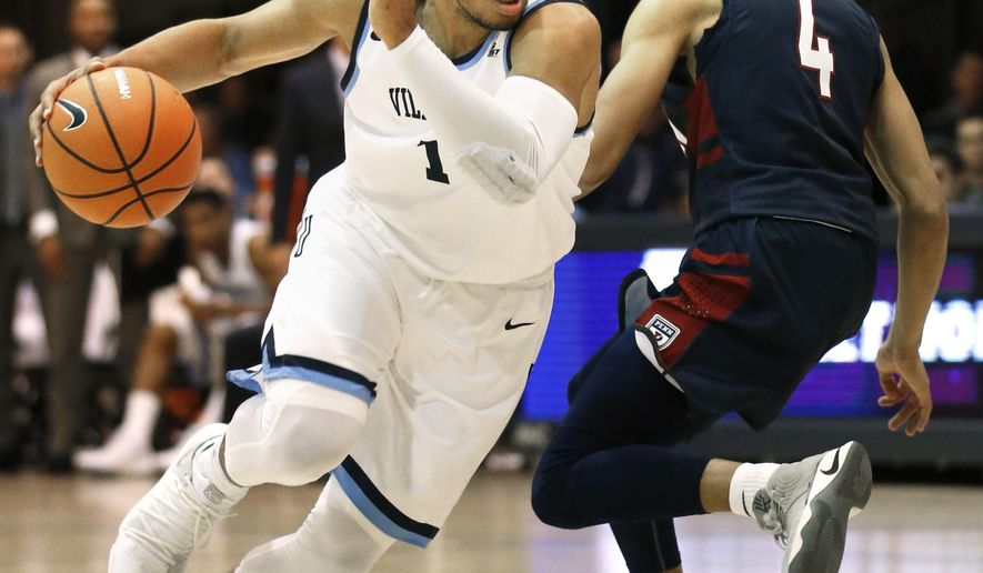 Villanova guard Jalen Brunson (1) drives past Pennsylvania guard Darnell Foreman (4) during the first half of an NCAA college basketball game, Wednesday, Nov. 29, 2017, in Villanova, Pa. (AP Photo/Laurence Kesterson)