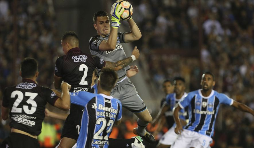 Gremio's goalkeeper, Marcelo Grohe, of Brazil, secures the ball during the final Copa Libertadores championship soccer match against Argentina's Lanus in Buenos Aires, Argentina, Wednesday, Nov. 29, 2017. (AP Photo/Esteban Felix)