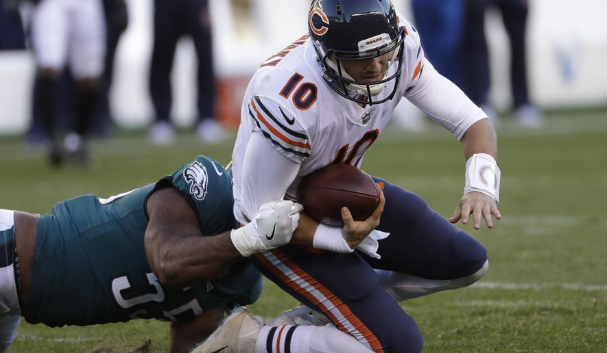 Chicago Bears' Mitchell Trubisky, right, is tackled by Philadelphia Eagles' Brandon Graham during the second half of an NFL football game, Sunday, Nov. 26, 2017, in Philadelphia. (AP Photo/Michael Perez)