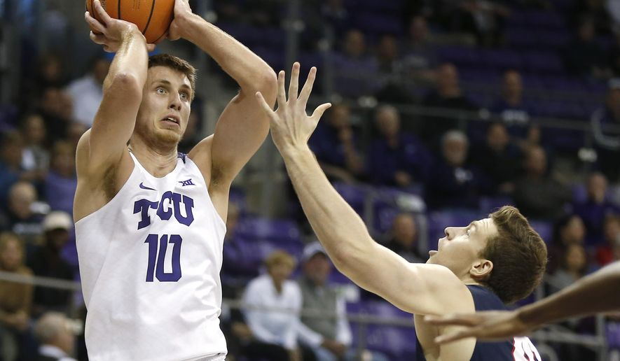 TCU forward Vladimir Brodziansky (10) shoots over Belmont center Tyler Hadden during the first half of an NCAA college basketball game Wednesday, Nov. 29, 2017, in Fort Worth, Texas. (AP Photo/Ron Jenkins)