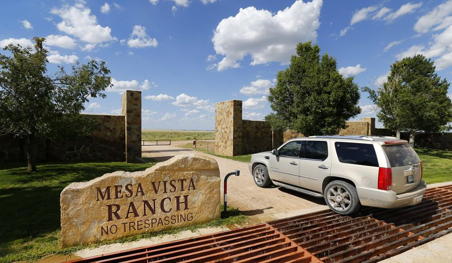 This photo taken May 30, 2017, shows businessman T. Boone Pickens entering a gate on his Mesa Vista Ranch in the panhandle of Texas near the town of Miami. Pickens wants to sell his prized ranch, covering more than 100 square miles in the Texas Panhandle, for $250 million. Pickens on Wednesday, Nov. 29, 2017, announced he's offering his Mesa Vista Ranch, about 90 miles northeast of Amarillo. Pickens in October put his Dallas mansion on the market for $5.9 million. (Tom Fox/The Dallas Morning News via AP)