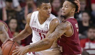 Nebraska's Evan Taylor (11) is defended by Boston College's Ky Bowman, right, during the first half of an NCAA college basketball game in Lincoln, Neb., Wednesday, Nov. 29, 2017. (AP Photo/Nati Harnik)