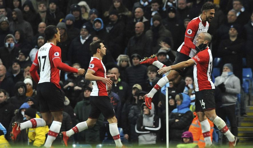 Southampton's Oriol Romeu, right, celebrates after scoring during the English Premier League soccer match between Manchester City and Southampton at Etihad stadium, in Manchester, England, Wednesday, Nov. 29, 2017. (AP Photo/Rui Vieira)