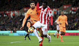 Stoke City's Mame Diouf, right, is challenged by Liverpool's Emre Can in action during their English Premier League soccer match at the bet365 Stadium in Stoke, England, Wednesday Nov. 29, 2017. (David Davies/PA via AP)