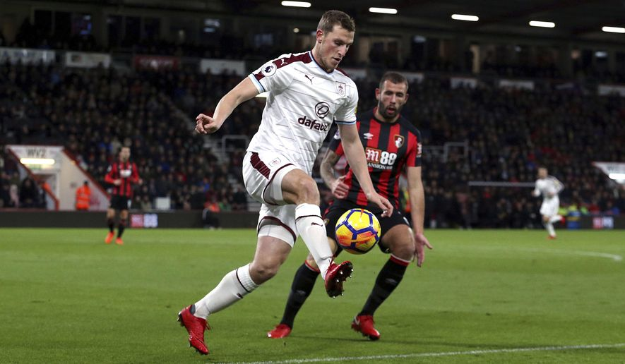 Burnley's Chris Wood, left, and AFC Bournemouth's Steve Cook in action during their English Premier League soccer match at the Vitality Stadium in Bournemouth, England, Wednesday Nov. 29, 2017. (Steven Paston/PA via AP)
