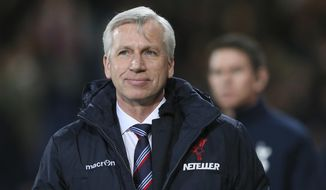 FILE - In this Saturday, Jan. 10, 2015 file photo, Crystal Palace manager Alan Pardew smiles as he arrives for the English Premier League soccer match between Crystal Palace and Tottenham Hotspur at Selhurst Park, London, England. Pardew has been hired as coach of West Bromwich Albion, securing a return to the Premier League after nearly a year out of management, it was reported on Wednesday, Nov. 29, 2017. (AP Photo/Tim Ireland, File)