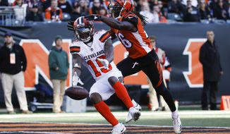 Cleveland Browns wide receiver Corey Coleman (19) drops a pass near Cincinnati Bengals cornerback Josh Shaw (26) in the second half of an NFL football game, Sunday, Nov. 26, 2017, in Cincinnati. (AP Photo/Frank Victores)