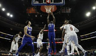 Philadelphia 76ers' Joel Embiid (21) goes up for a dunk during the first half of an NBA basketball game against the Cleveland Cavaliers, Monday, Nov. 27, 2017, in Philadelphia. (AP Photo/Matt Slocum)