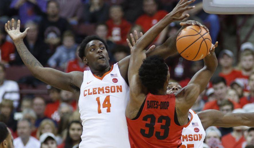 Clemson's Elijah Thomas, left, blocks the shot of Ohio State's Keita Bates-Diop during the first half of an NCAA college basketball game Wednesday, Nov. 29, 2017, in Columbus, Ohio. (AP Photo/Jay LaPrete)