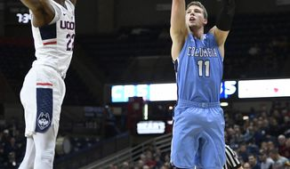 Columbia's Lukas Meisner, right, shoots over Connecticut's Terry Larrier, left, in the first half of an NCAA college basketball game, Wednesday, Nov. 29, 2017, in Storrs, Conn. (AP Photo/Jessica Hill)