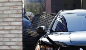 Rep. John Conyers, D-Mich., leaves his home Wednesday, Nov. 29, 2017, in Detroit. Rep. Conyers is being pressured by some in Washington to resign. Rep. Conyers recently stepped down from his post as top Democrat on the House Judiciary Committee after facing allegations of sexual harassment by former staffers. (AP Photo/Paul Sancya)