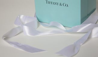 FILE - In this Monday, May 22, 2017, file photo, a gift box from Tiffany & Co. is arranged for a photo in Surfside, Fla. Tiffany & Co. reports earnings, Wednesday, Nov. 29, 2017. (AP Photo/Wilfredo Lee, File)