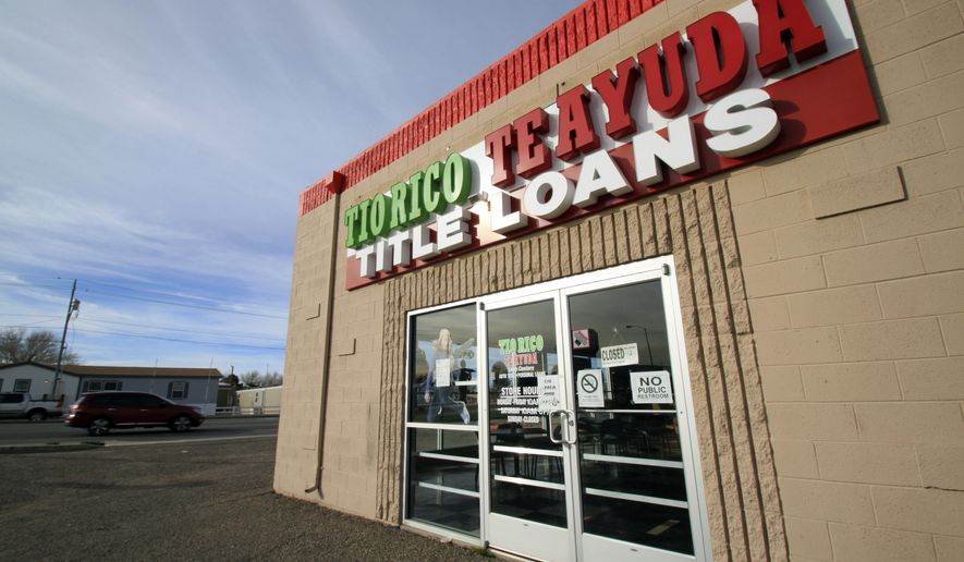 FILE - This Feb. 3, 2017, file photo shows the Tio Rico Loan Center in Albuquerque, N.M. New Mexico is moving forward with an overhaul of the storefront lending marketplace that will cap interest rates at an annual 175 percent starting Jan. 1, 2018, while state regulators said Wednesday, Nov. 29, that they will need several more months to write companion regulations that bolster consumer protections and enforcement. (AP Photo/Susan Montoya Bryan, File)