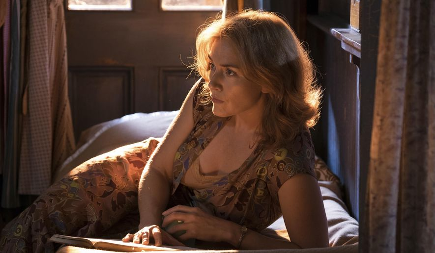 "This image released by Amazon Studios shows Kate Winslet in a scene from ""Wonder Wheel."" (Jessica Miglio/Amazon Studios via AP)"