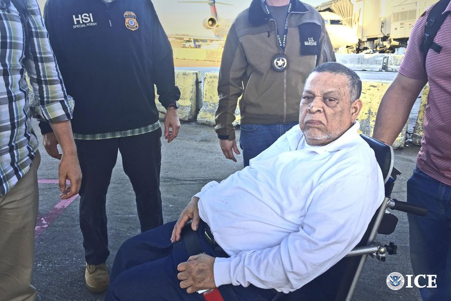 Former Salvadoran Col. Inocente Orlando Montano Morales is seen Tuesday, Nov. 28 2017, surrounded by U.S. federal agents before boarding a flight from Atlanta to Madrid, Spain. Montano arrived Wednesday morning in Madrid to face charges that he helped plot the 1989 killings of six Jesuit priests, five of whom were Spanish, during El Salvador's civil war. (Bryan D. Cox/U.S. Immigration and Customs Enforcement via AP)
