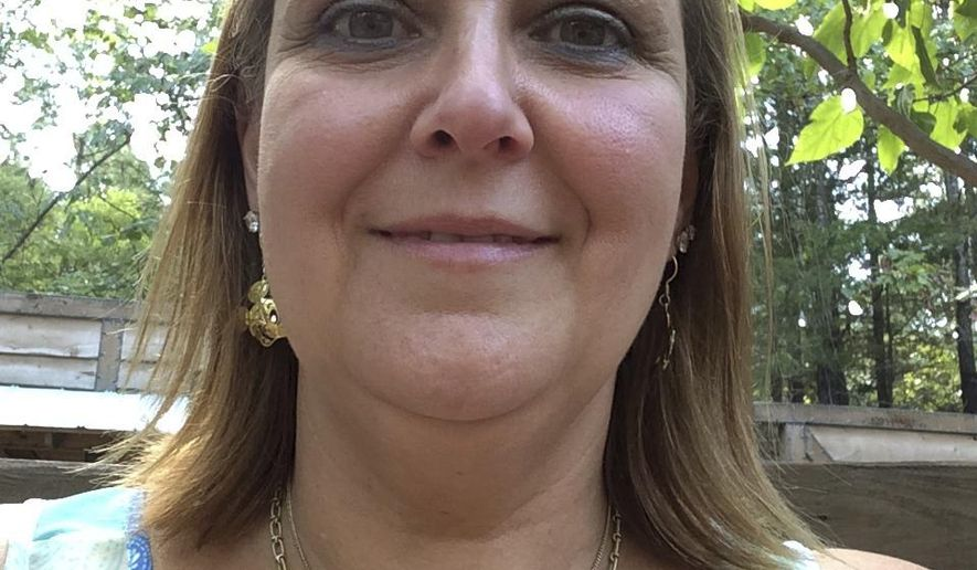 In this 2015 photo provided by Anne Vickers, Vickers poses for a selfie in Branson, Mo. Vickers said she benefited while taking part in a study where she received monthly shots of a low dose of erenumab, a preventive medicine developed specifically for migraines. Studies of two medicines, erenumab and fremanezumab, given as shots every 1 to 3 months, found they cut the frequency of the notoriously painful and disabling headaches. (Anne Vickers via AP)