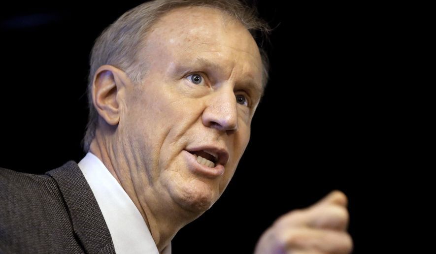 FILE - In this March 4, 2015 file photo, Illinois Republican Gov. Bruce Rauner speaks at an event in Springfield, Ill. Illinois' Medicaid patients will see a change in health care coverage Jan. 1. The Department of Healthcare and Family Services has signed a $60 billion deal with seven insurers to cover nearly three million low-income clients. Lawmakers have protested the way that Gov. Rauner's administration procured the deal. State Rep. Greg Harris D-Chicago has convened a hearing Thursday, Nov. 30, 2017 in Chicago on the issue. (AP Photo/Seth Perlman, File)