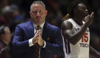 Virginia Tech head coach Buzz Williams stands by the court before an NCAA college basketball game against Iowa in Blacksburg, Va., Tuesday, Nov. 28 2017. (Matt Gentry/The Roanoke Times via AP)