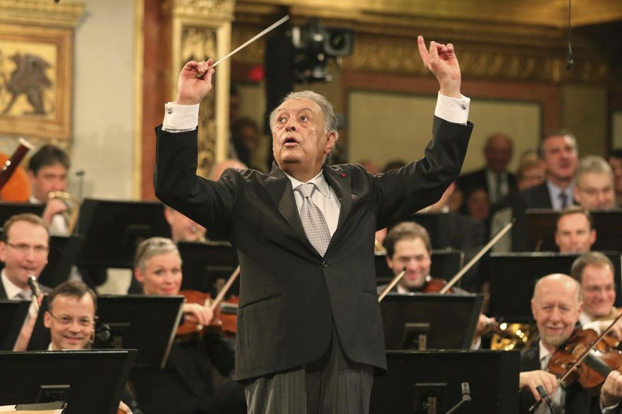 FILE - In this Jan. 1, 2015 file photo, conductor Zubin Mehta appears with the Vienna Philharmonic Orchestra during the traditional New Year's concert at the Musikverein in Vienna, Austria. Milan's La Scala announced on Wednesday Nov. 29, 2017, a shoulder operation is forcing conductor Zubin Mehta to take a break for at least three months and the famed opera house to change its lineup. (AP Photo/Ronald Zak, File)