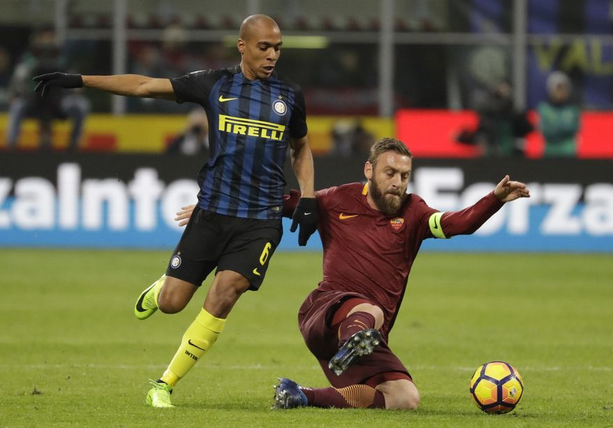 FILE - In this Sunday, Feb. 26, 2017 file photo, Roma's Daniele De Rossi, right, and Inter Milan's Joao Mario vie for the ball during an Italian Serie A soccer match between Inter Milan and Roma, at the San Siro stadium in Milan, Italy. For all his leadership qualities, Daniele De Rossi still can't shake his tendency to overreact to physical contact. The Roma midfielder's slap to the face of Genoa's Gianluca Lapadula over the weekend was the latest in a long line of undisciplined behavior. (AP Photo/Luca Bruno, File)
