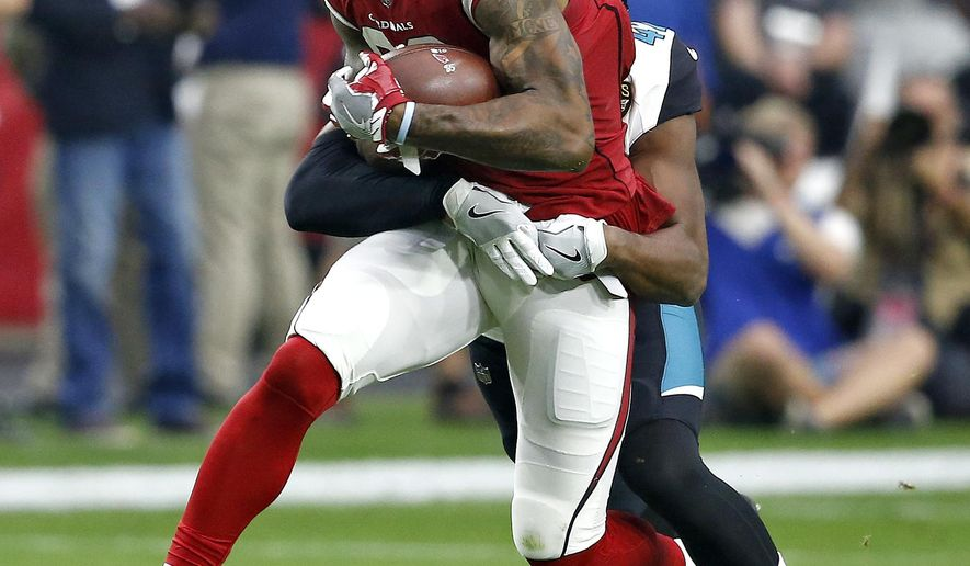 Arizona Cardinals tight end Ricky Seals-Jones, front, pulls in a first down catch as Jacksonville Jaguars strong safety Barry Church makes the tackle during the first half of an NFL football game, Sunday, Nov. 26, 2017, in Glendale, Ariz. (AP Photo/Ross D. Franklin)