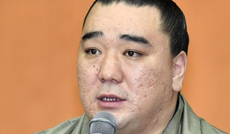 "Mongolian grand champion Harumafuji speaks during a press conference to announce his retirement, in Dazaifu, southwestern Japan, Wednesday, Nov. 29, 2017. Harumafuji decided to retire from sumo after allegations that he assaulted lower-ranked wrestler Takanoiwa and tarnished the image of Japan's national sport. His stablemaster Isegahama said that Harumafuji ""has caused great trouble to the association and the public"" and that the grand champion bears responsibility. (Chika Oshima/Kyodo News via AP)"