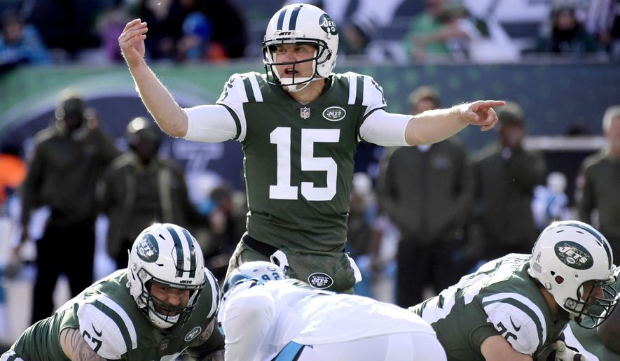 In this Nov. 26, 2017, photo, New York Jets quarterback Josh McCown (15) talks to his line before the snap against the Carolina Panthers during the first half of an NFL football game in East Rutherford, N.J. McCown realizes that he's not a long-term answer at quarterback for the New York Jets. But at 38, he's not thinking too far ahead. His focus is squarely on the Kansas City Chiefs and not whether he'll remain under center the rest of the season or even continue to play beyond this year. (AP Photo/Bill Kostroun)