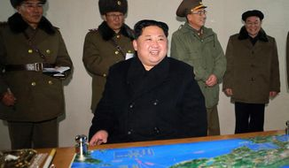"In this photo provided on Thursday, Nov. 30, 2017, by the North Korean government, North Korean leader Kim Jong-un inspects an intercontinental ballistic missile test in North Korea on Wednesday, Nov. 29. Independent journalists were not given access to cover the event depicted in this image distributed by the North Korean government. The content of this image is as provided and cannot be independently verified. Korean language watermark on image as provided by source reads: ""KCNA"" which is the abbreviation for Korean Central News Agency. (Korean Central News Agency/Korea News Service via AP)"