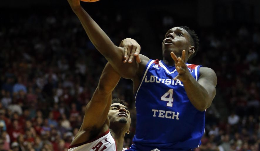Louisiana Tech guard DaQuan Bracey (4) is fouled by Alabama guard Avery Johnson Jr. (5) as he goes up for a shot during the first half of an NCAA college basketball game, Wednesday, Nov. 29, 2017, in Tuscaloosa, Ala. (AP Photo/Butch Dill)