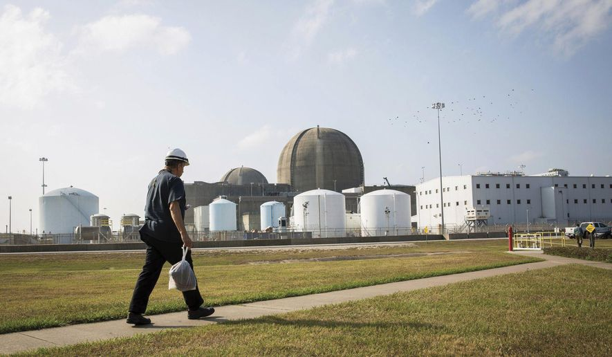 In this Nov. 1, 2017 photo, an South Texas Project Nuclear Operating Company employee walks to the plant entrance in Wadsworth, Texas. (Angela Piazza/The Victoria Advocate via AP)