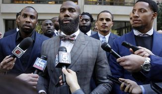 In this Tuesday, Oct. 17, 2017, file photo, Former NFL football player Anquan Boldin, left, Philadelphia Eagles Malcolm Jenkins, center, and San Francisco 49ers Eric Reid, right, speak to the media outside the league's headquarters after meetings in New York. San Francisco 49ers linebacker Eric Reid says he left The Players Coalition because founder Malcolm Jenkins excluded Colin Kaepernick from meetings, and asked players if they would stop protesting the anthem if the NFL made a charitable donation to causes they support. (AP Photo/Richard Drew, File)