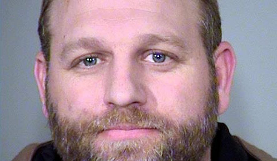FILE - This Jan. 27, 2016, file photo provided by the Multnomah County Sheriff's Office shows Ammon Bundy. Cliven Bundy, 71, a Nevada rancher and states' rights figure refused a federal judge's offer Wednesday, Nov. 29, 2017, to be free on house arrest during his trial with two sons on charges in an armed standoff with government agents that stopped a cattle round-up in 2014. U.S. District Judge Gloria Navarro said Ammon Bundy and co-defendant Ryan Payne can be freed Thursday, Nov. 30, to home detention. (Multnomah County Sheriff via AP, File)