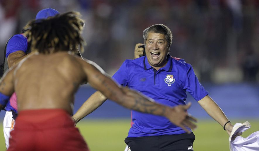 FILE - In this Tuesday, Oct. 10, 2017 filer, Panama's coach Hernan Dario Gomez, from Colombia, celebrates with his player Roman Torres who scored his team's second goal, after a 2018 Russia World Cup qualifying soccer match against Costa Rica in Panama City. (AP Photo/Arnulfo Franco, File)