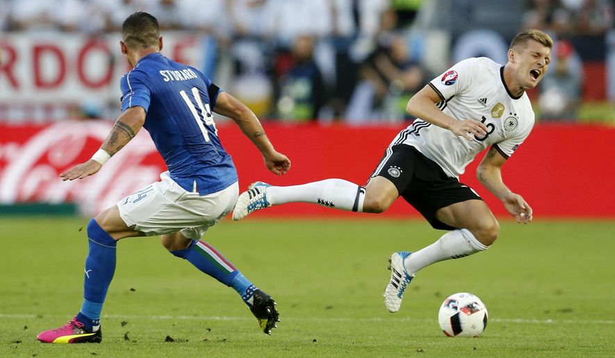 FILE - In this Saturday, July 2, 2016 filer, Germany's Toni Kroos, right, falls after he was fouled by Italy's Stefano Sturaro during the Euro 2016 quarterfinal soccer match between Germany and Italy, at the Nouveau Stade in Bordeaux, France. (AP Photo/Michael Probst, File)
