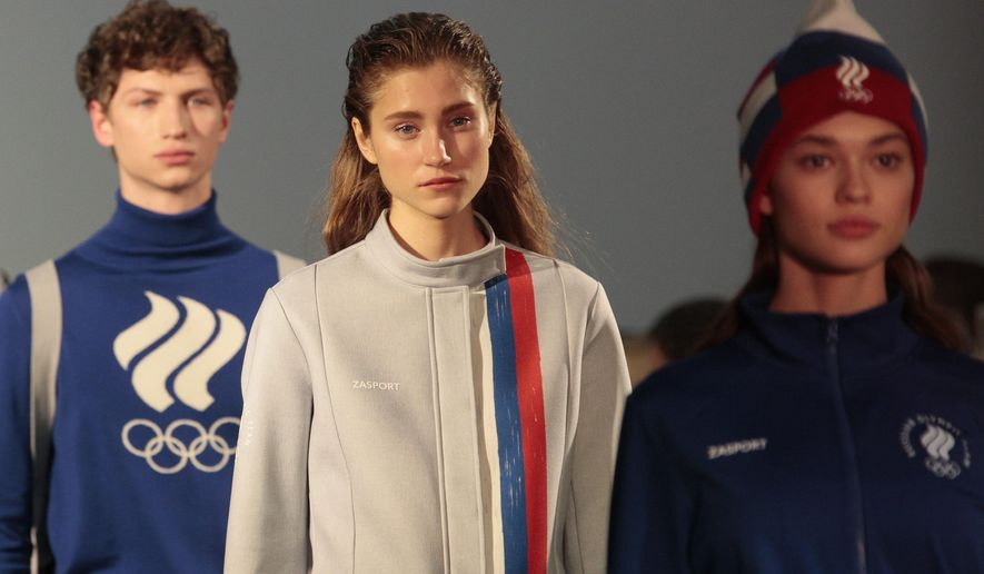 Model displays creation of designer Anastasia Zadorina during the presentation of the national olympic team's uniform collection, in Moscow, Russia, on Wednesday, Nov. 29, 2017. Russia has launched its uniform for February's Winter Olympics - even as it faces a possible ban for doping offences. (AP Photo/Ivan Sekretarev)
