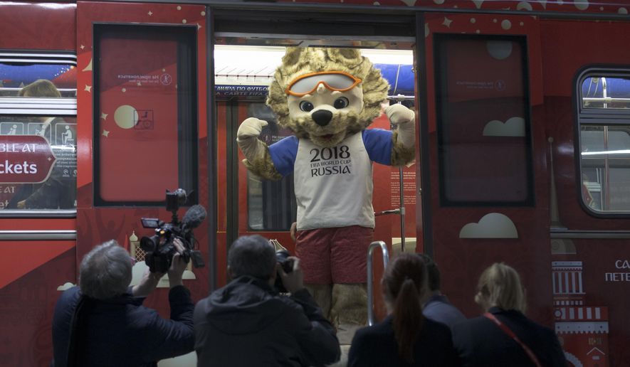 The mascot of the 2018 World Cup, the wolf named Zabivaka, peers out of the metro train branded for the 2018 World Cup during a ceremony in Moscow, Russia, on Tuesday, Nov. 28, 2017. (AP Photo/Ivan Sekretarev)