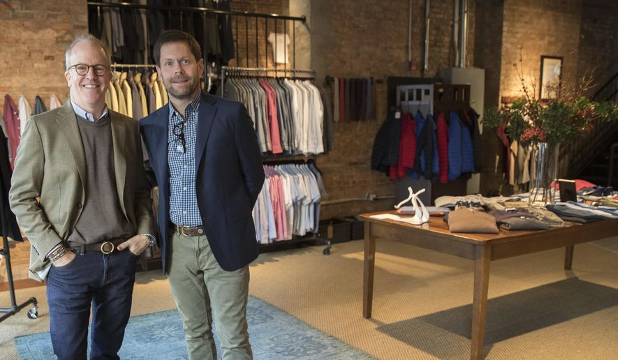 In this Tuesday, Nov. 21, 2017, photo, designer Peter Manning, left, and Jeff Hansen, CEO of Peter Manning, pose for a photo in the Peter Manning showroom in New York. The clothing retailer for men 5 feet 8 inches tall or under, tries to convey to shoppers that it offers quality at a fair price. (AP Photo/Mary Altaffer)