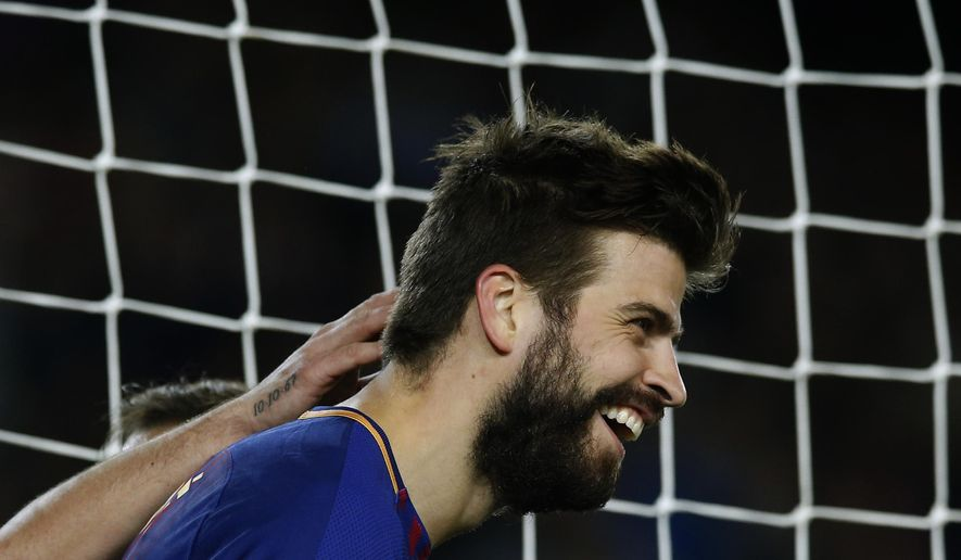 FC Barcelona's Gerard Pique celebrates after scoring during a Spanish Copa del Rey round of 32 second leg soccer match between FC Barcelona and Murcia at the Camp Nou stadium in Barcelona, Wednesday, Nov. 29, 2017. (AP Photo/Manu Fernandez)