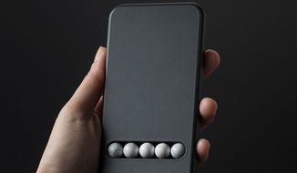 """The """"Substitute Phone"""" from Austrian designer Klemen Schillinger provides therapeutic motions for those who can't stop scrolling, zooming and swiping. (Image from Klemen Schillinger/Dezeen)"""