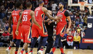 New Orleans Pelicans' DeMarcus Cousins (0) and teammates try to calm down Anthony Davis (23) as he is ejected for his second technical foul during the team's NBA basketball game against the Minnesota Timberwolves in New Orleans, Wednesday, Nov. 29, 2017. (Sophia Germer/The Advocate via AP)