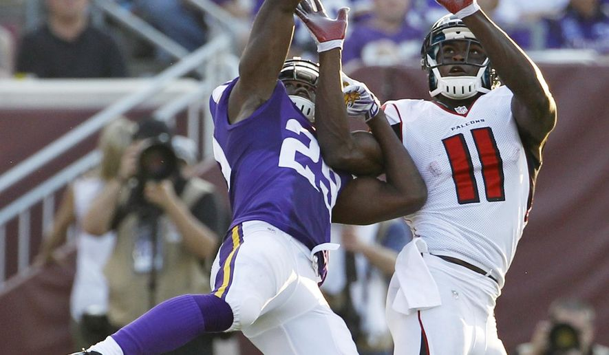 FILE - In this Sept. 28, 2014, file photo, Minnesota Vikings cornerback Xavier Rhodes, left, breaks up a pass intended for Atlanta Falcons wide receiver Julio Jones (11) during the second half of an NFL football game, in Minneapolis. Vikings cornerback Xavier Rhodes is often asked to shadow the opponent's best wide receiver, and this week his assignment could be the toughest yet: Julio Jones, coming off a 253-yard game for the surging Falcons. (AP Photo/Ann Heisenfelt, File)